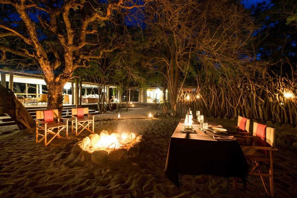 Big Cat Safaris - Rhino Sands outdoor eating area on the sand with fire Big Cat Safari Specials